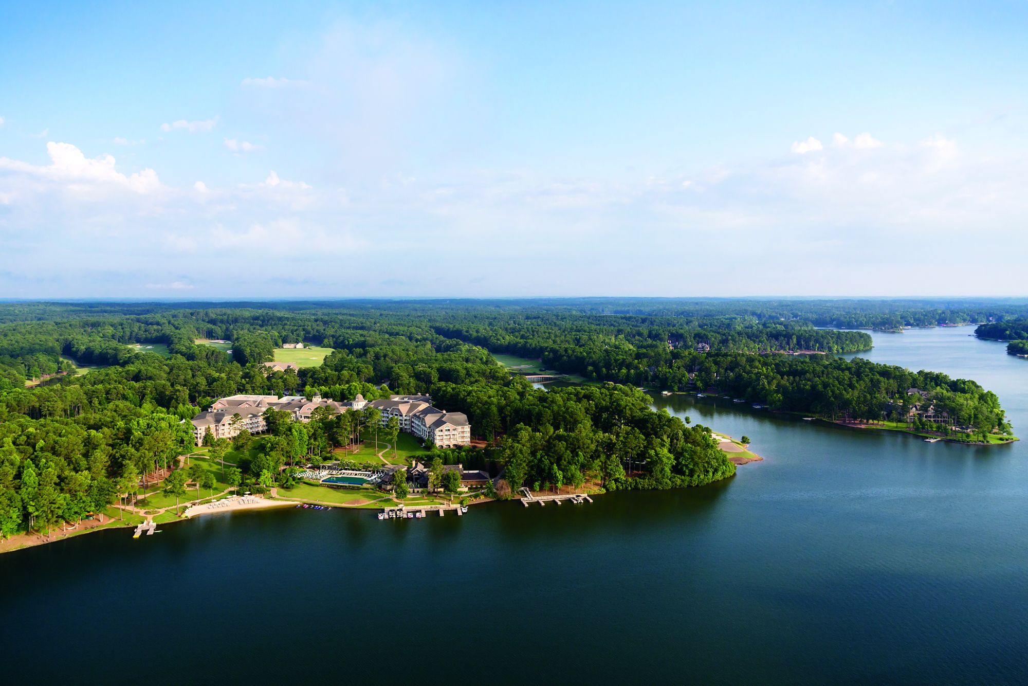 Aerial view of a building complex facing a large lake and