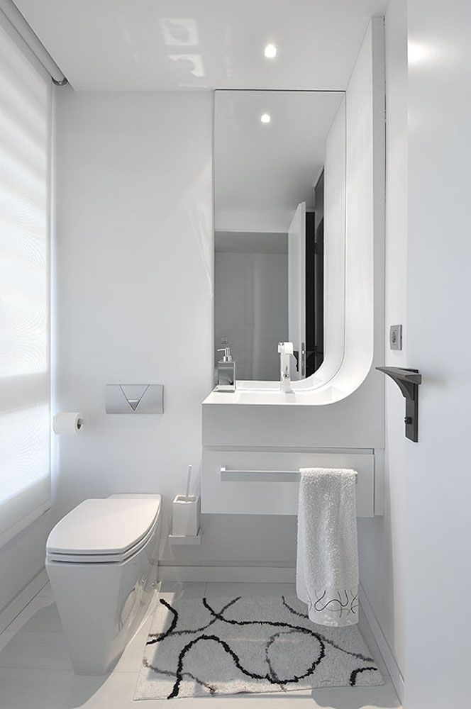 Modern white bathroom design from tradewinds imports for Modern small bathroom design