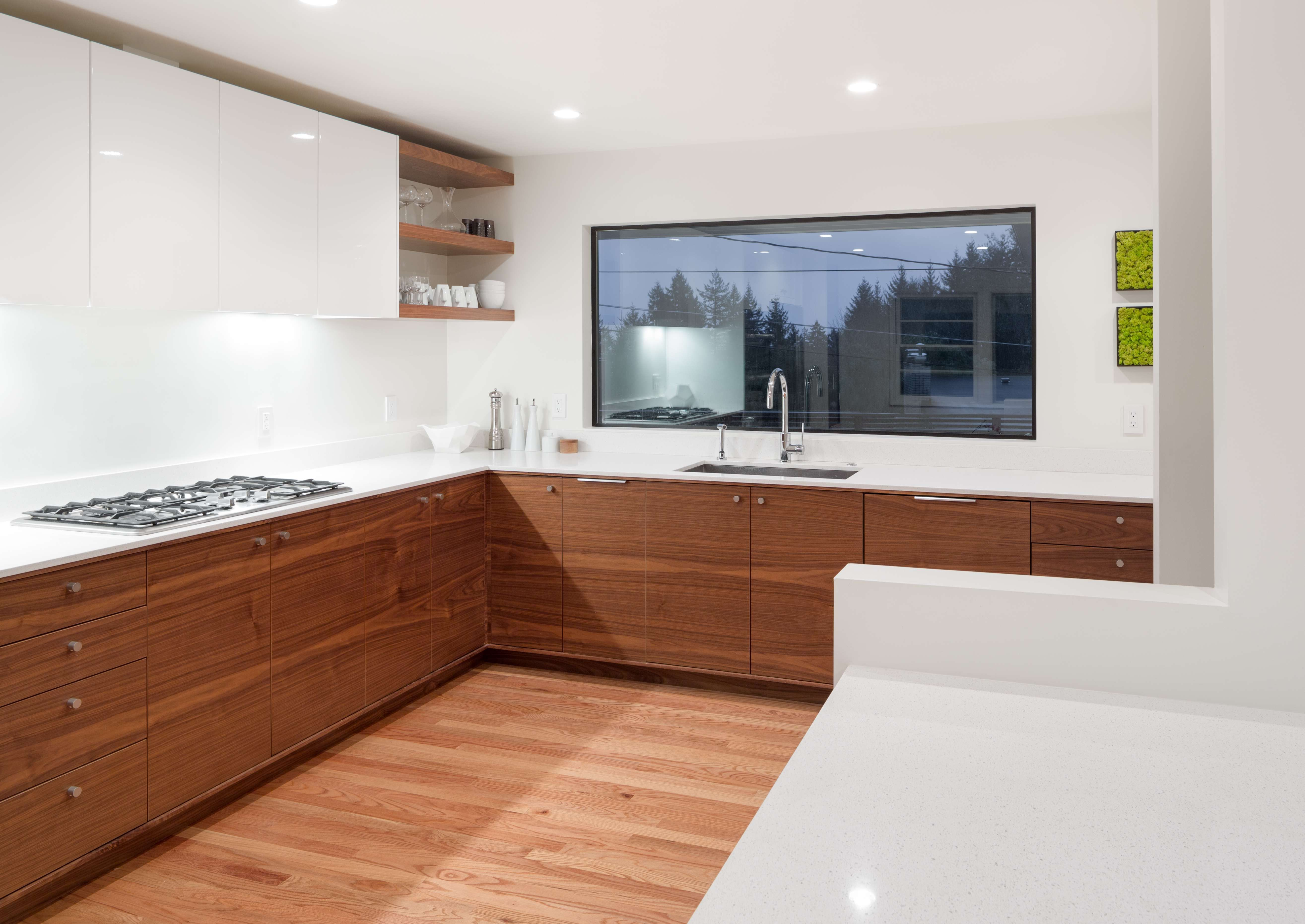 High Gloss White + Grain Matched Walnut Cabinets. White