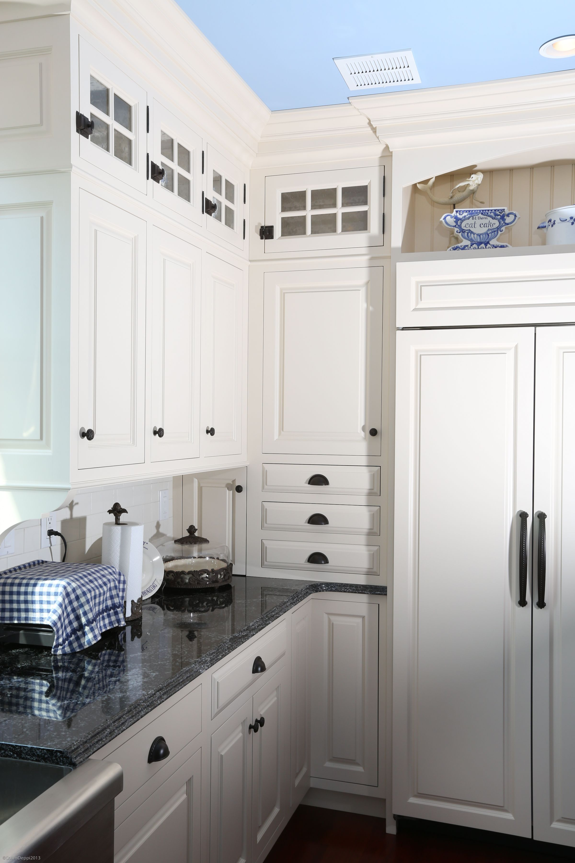 White Painted Cabinetry. Counter wall cabinet detail with 3 drawers ...