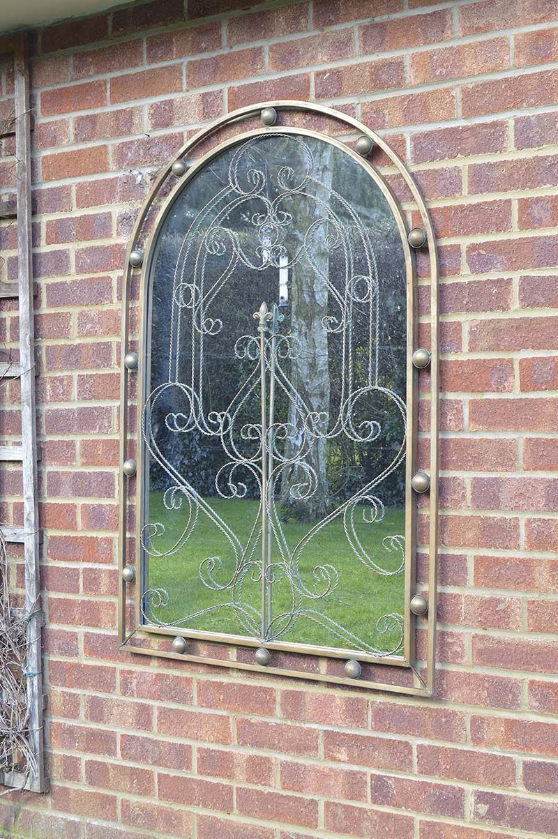 This stupendous bronze gothic garden mirror stands at 3 ft 11 by 2 8 and