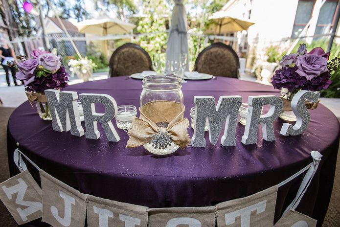 Mr And Mrs Table Decor At The Wedding Reception Purple Wedding