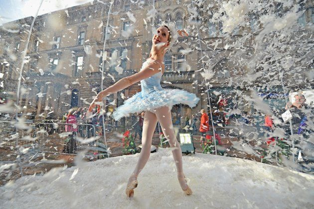 Claire Robertson from Scottish Ballet, poses dressed as the Good Snow Flake inside a life size snow globe on Buchanan Street during a promotion for Scottish Ballet's festive production of The Nutcracker on November 20, 2012 in Glasgow,Scotland.