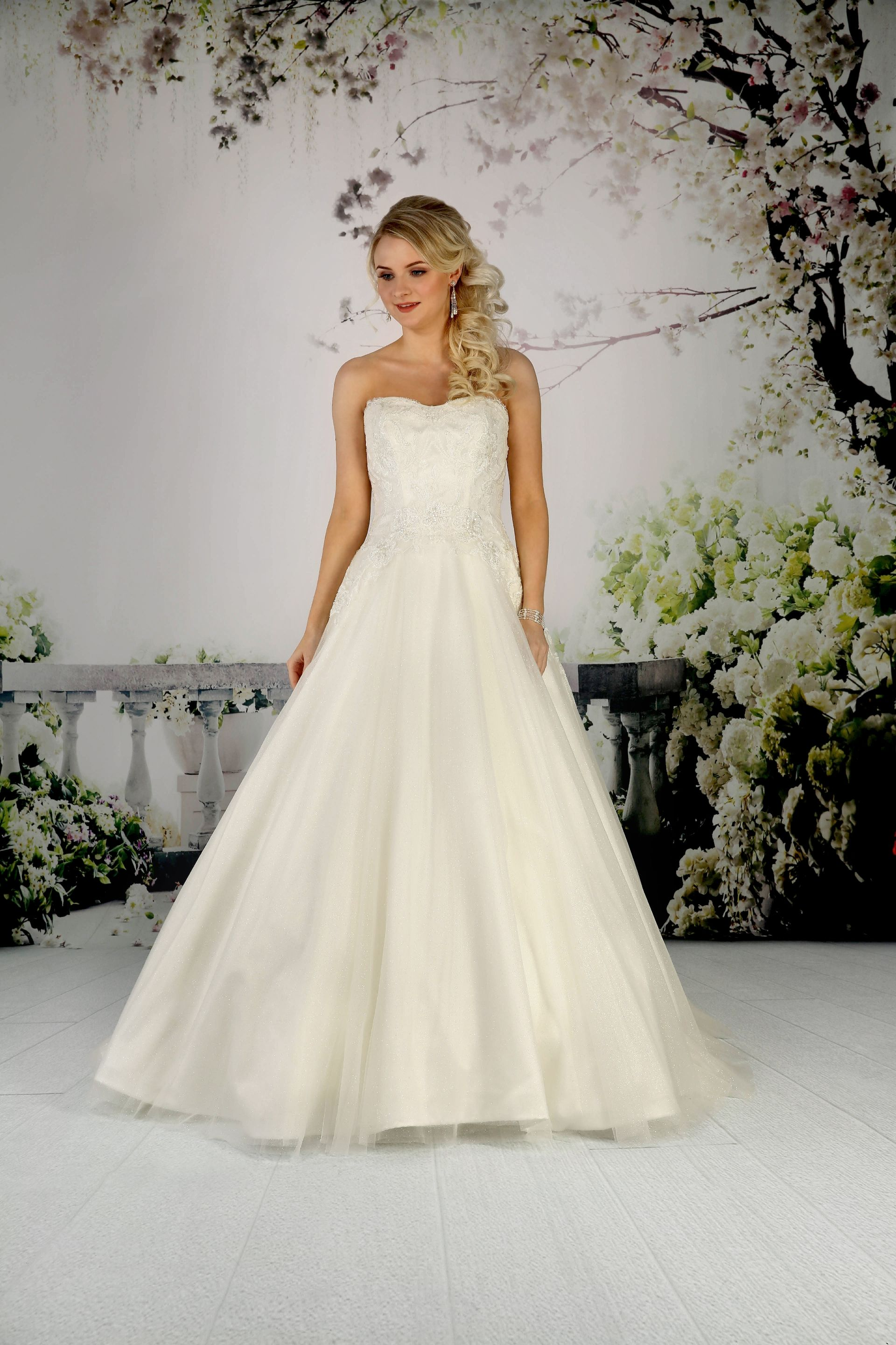 This glitter tulle bridal gown has an embellished lace bodice ...