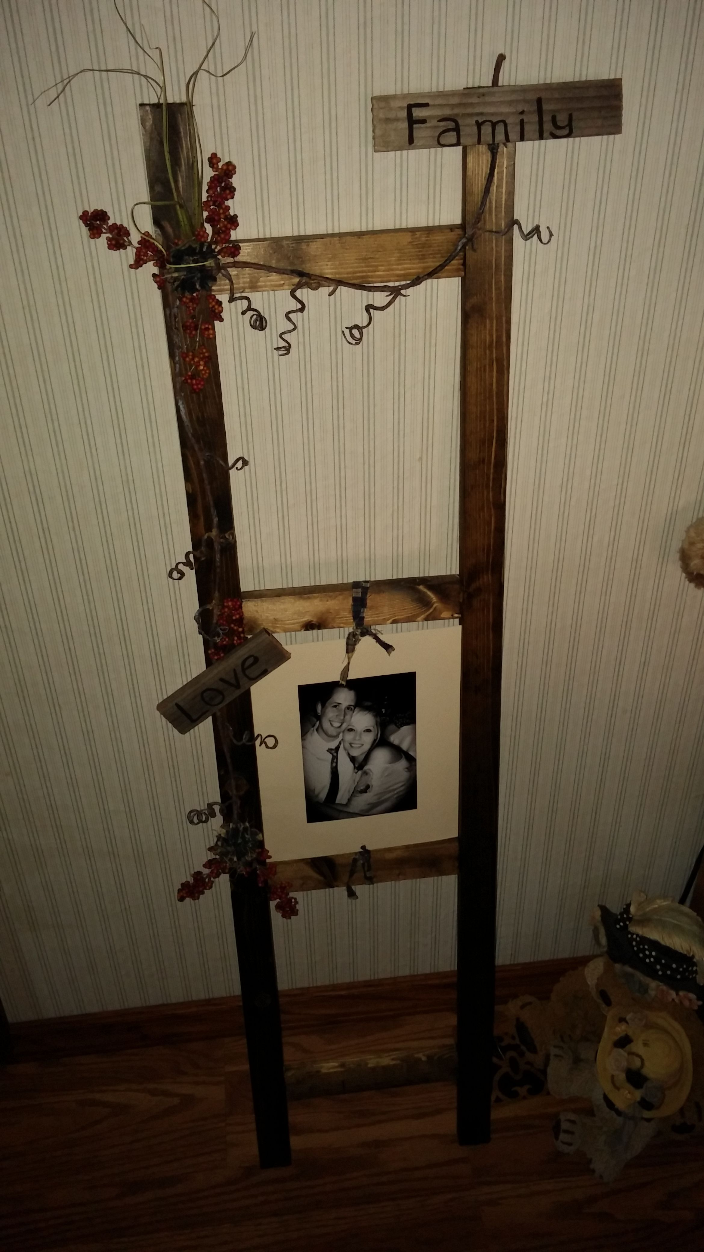 Made from scrap wood, ladder with family pics
