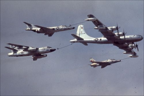 """flytofight:  """" A KB-50 Superfortress simultaneously refuels an F-101 Voodoo, B-66 Destroyer, and an F-100 Super Sabre.  """""""