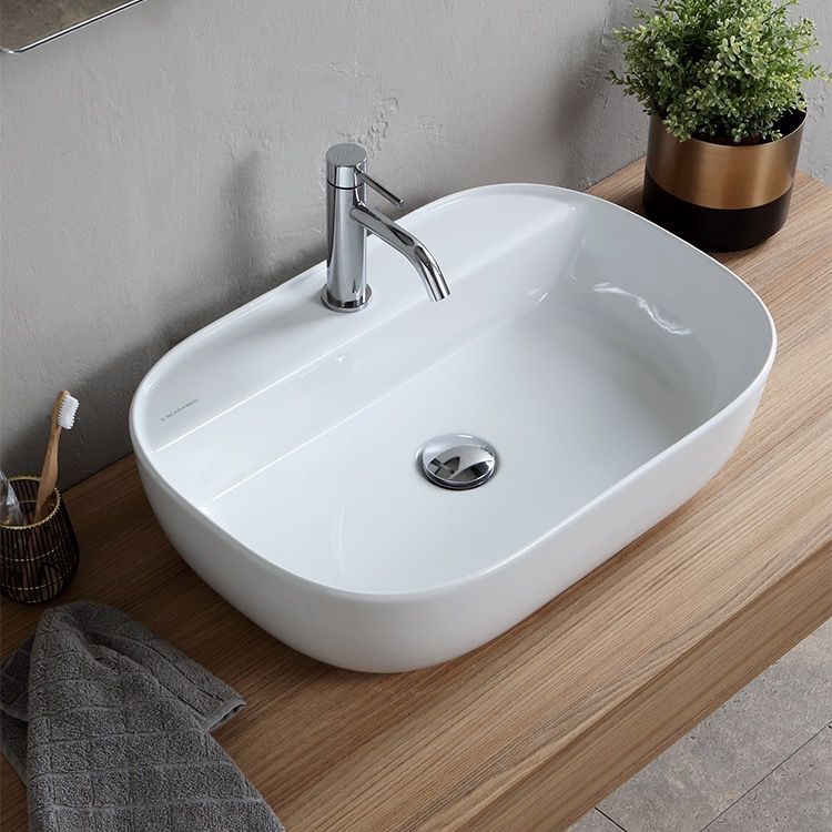 Oval White Ceramic Vessel Sink With Images Bathroom Sink Wall