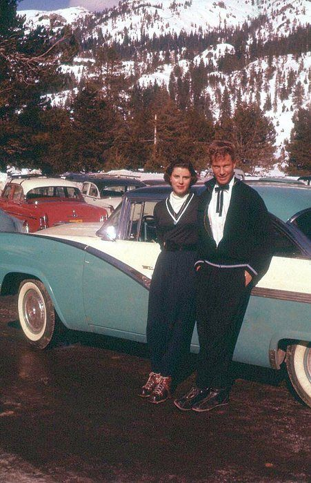 Photo Couple By Car In Mountains Color Print Winter Wool Vintage Fashion Style Shoes Hair Pants Sweater Bow Tie Bolo Black White