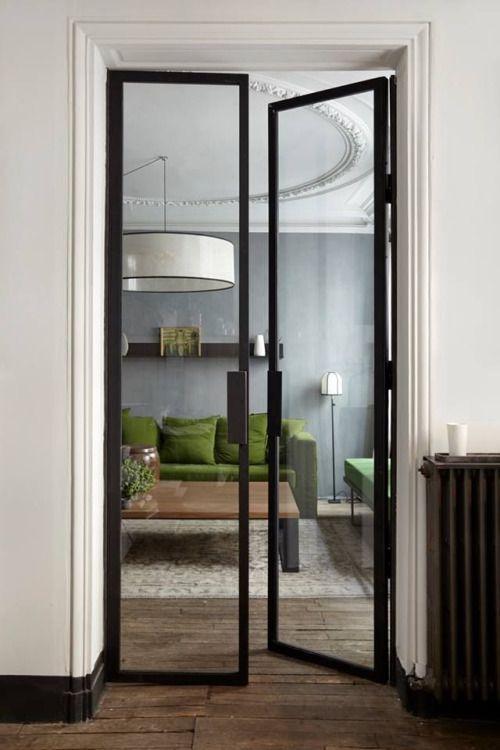 Interior, sleek, black steel and glass doors.