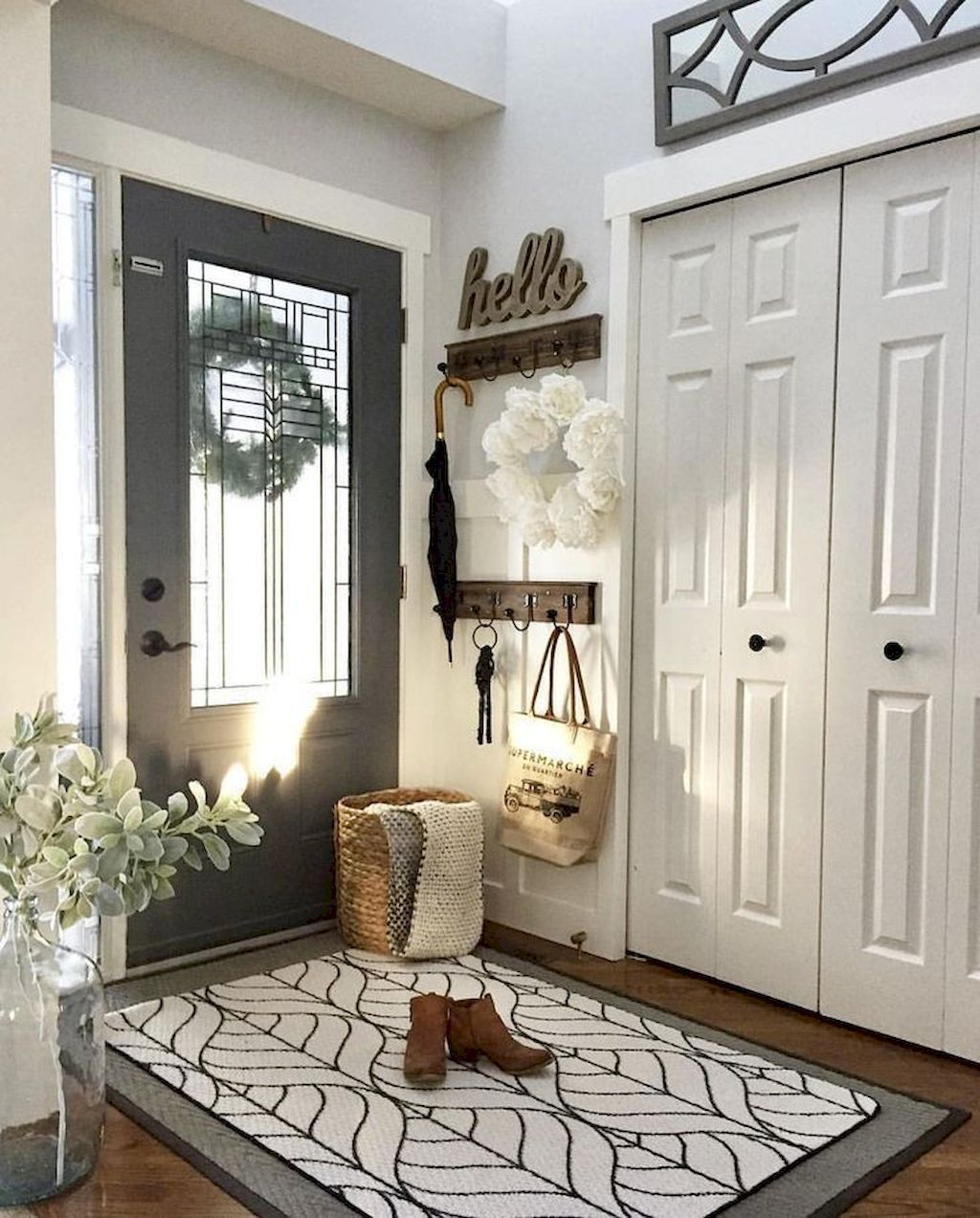 Modern farmhouse foyer makeover  new coat of paint creates an amazing transformation in decorating also rh pinterest