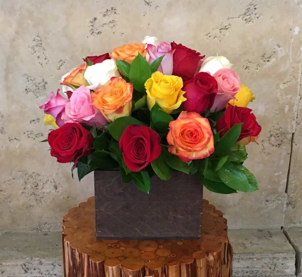 Mix color Premium Roses and leaves in wood Box. Flower