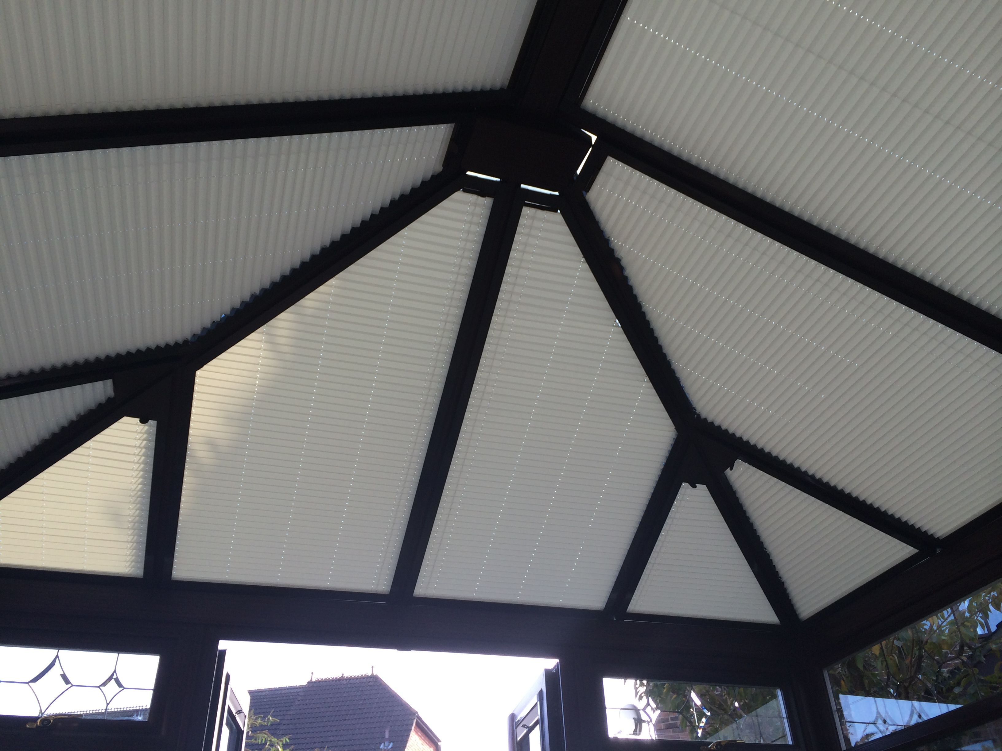 A Brown Conservatory Fitted With Perfect Fit International Pleated Roof Blinds With Brown Frames For A Conservatory Roof Blinds Custom Blinds Conservatory Roof