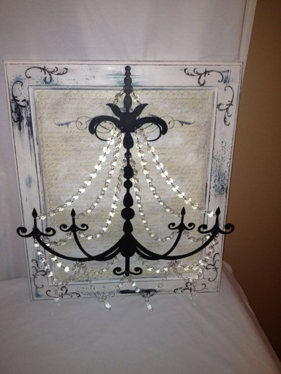 Metal Chandelier Wall Art In White Black And A Little Blue With Script  Writing Background Aged And Wood Frame