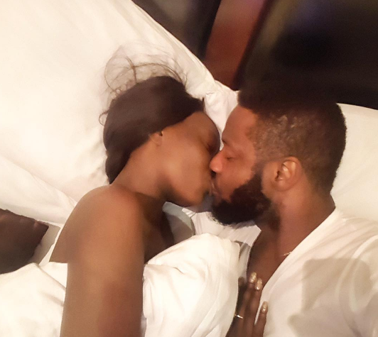 OAP Comedian Roby Ekpo Shares Photo Of Himself And His Wife Kissing In Bed