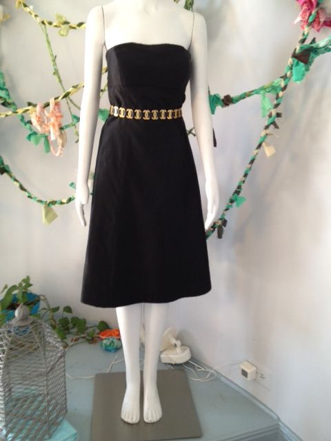 Chanel belt paired with a Prada dress. Does it get any better?