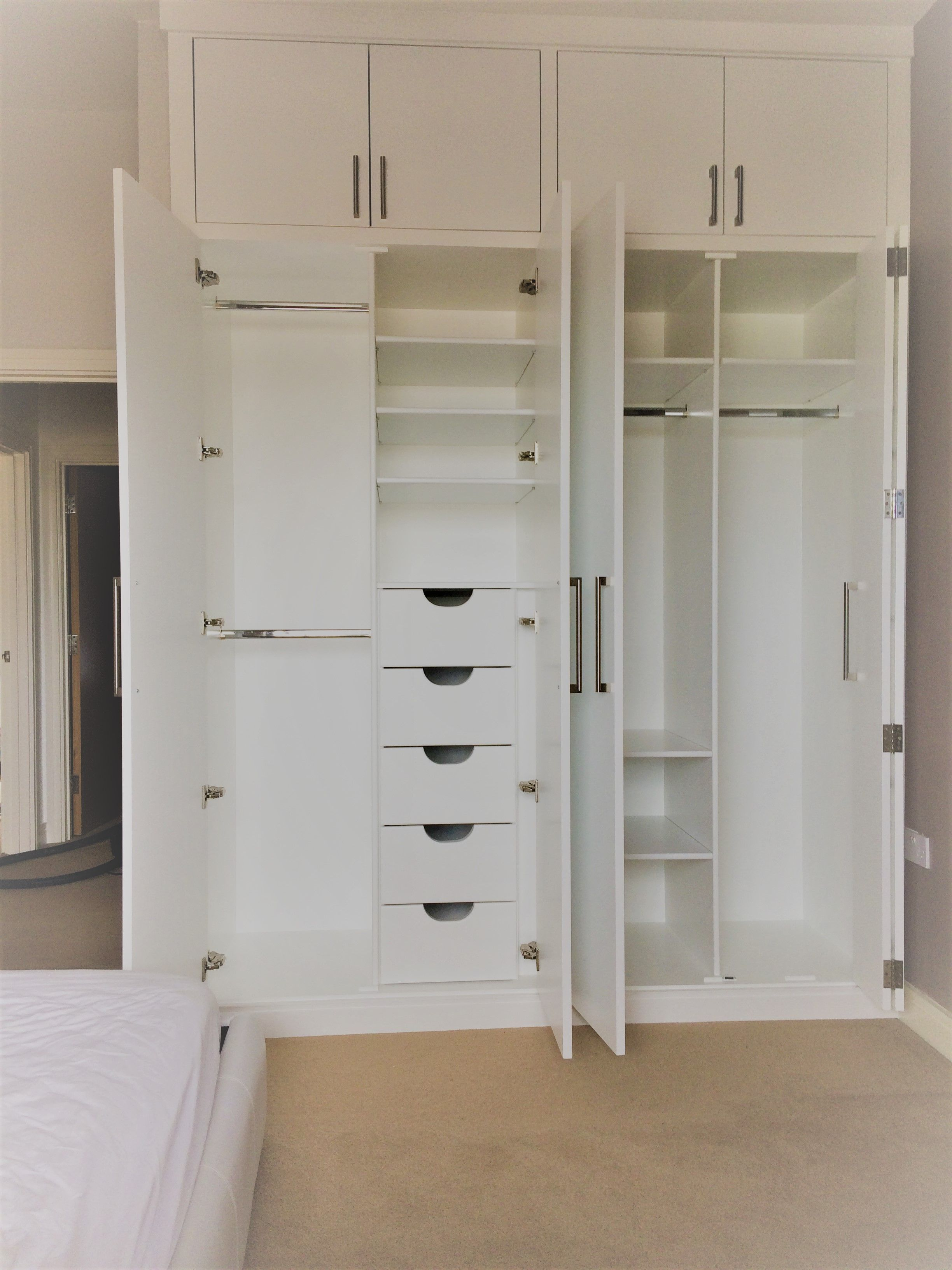 A bespoke floor to ceiling wardrobe | Bedroom cupboards ...