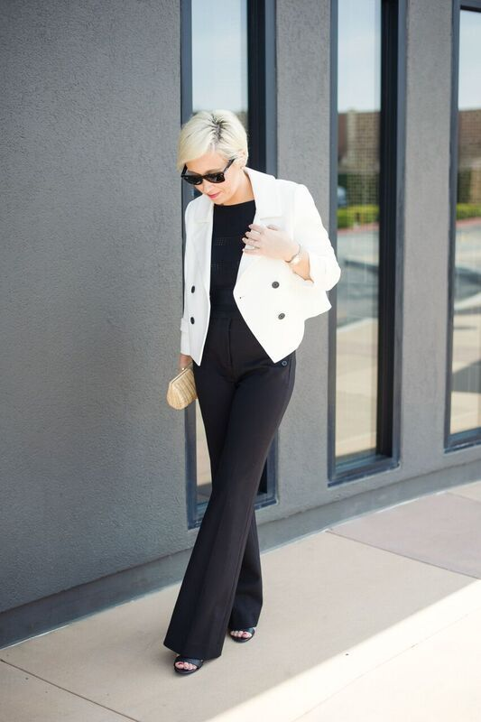 White blazer with black buttons