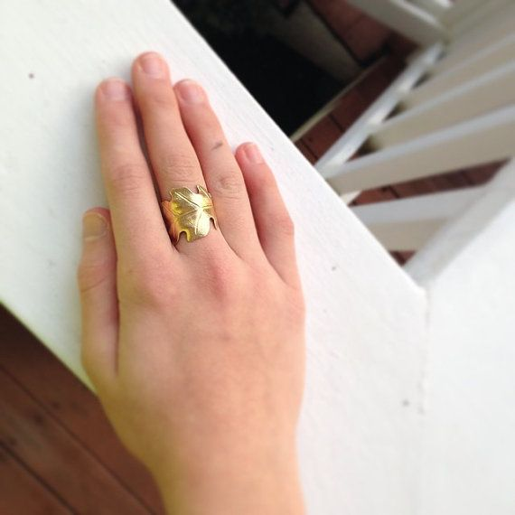 This is a fun golden raw brass oak leaf ring that is slightly adjustable. Light and delicate. This ring is made with a raw brass leaf charm and