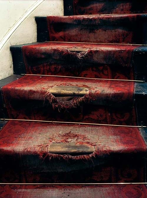 Looks Like A Bleeding Staircase. Kinda Cool. Black Stairs, Red, Ragged Rug.