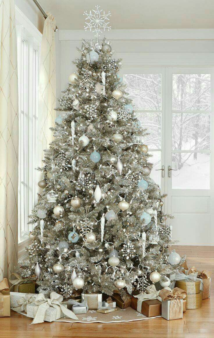 ice blue white silver it looks gorgeous on this color tree - White Christmas Tree With Blue And Silver Decorations