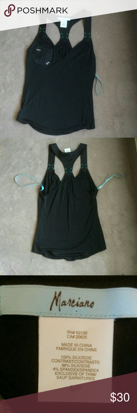 Marciano black tank blouse XS Marciano black tank with teal stitching. Silk material on the shoulders and pocket. Worn once and in excellent condition. NO TRADES. Marciano Tops Tank Tops