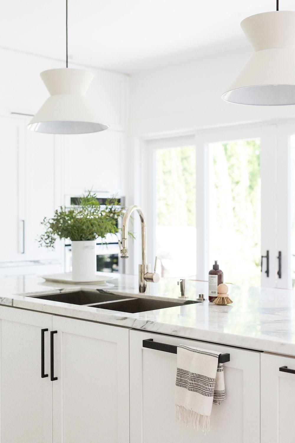 Farmhouse style kitchen with black hardware, polished