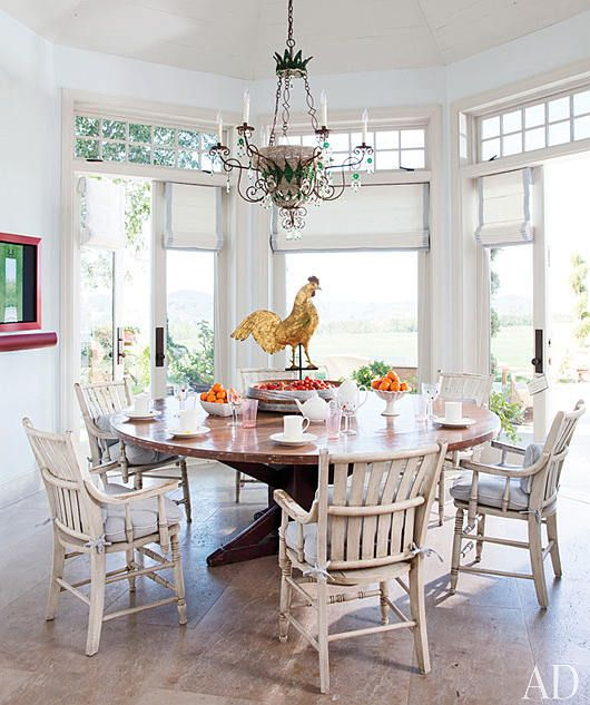 rustic chairs and a brass rooster weathervane give this bright and rh pinterest com