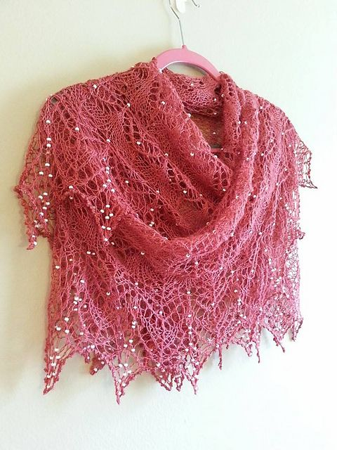 This little shawl is totally adorable and is simply dripping with beads – so romantic, so fragile, so delicate! With a 16 row lace pattern that can be repeated as many times as desired (or your yarn will allow) or even omitted, this little shawl can be knit time and time again, looking different each time.