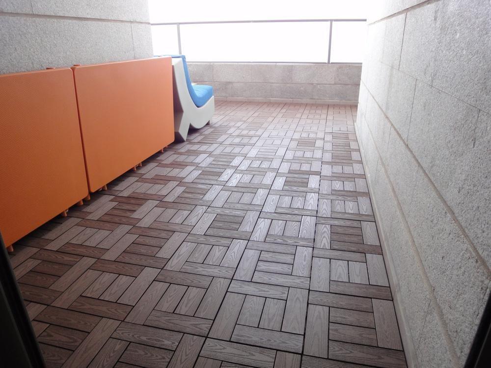 Kontiki Composite Interlocking Deck Tiles Building