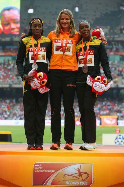 (L-R) Silver medalist Elaine Thompson of Jamaica, gold medalist Dafne Schippers of the Netherlands and bronze medalist Veronica Campbell-Brown of Jamaica pose on the podium during the medal ceremony for the Women's 200 metres final during day eight of the 15th IAAF World Athletics Championships Beijing 2015 at Beijing National Stadium