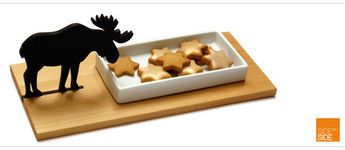 Is there a groovier cookie bowl? And yes, it's a moose sticking its head in to check out the action! A star shaped cookie cutter comes with the package – for a bit of European style Christmas baking tradition… But we think it looks dead cute enough to use at any time of the year - with lots of other alternatives to fill it up with… & bring a smile to your face.   Material: rectangular ceramic dish sits on a grooved wooden board (Norwegian maple) plus little wooden moose.