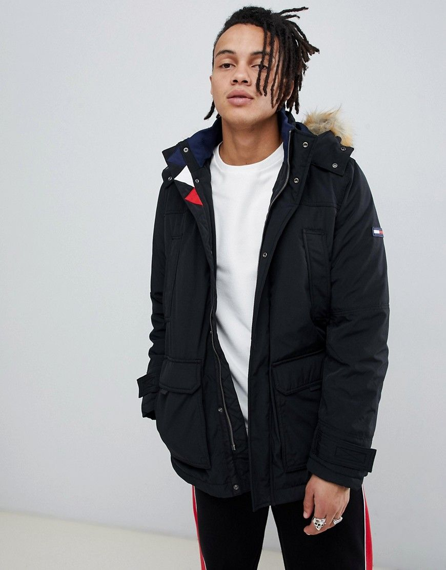 f7b13264 TOMMY JEANS TECHNICAL QUILTED PARKA FAUX FUR TRIM HOOD IN BLACK - BLACK. # tommyjeans #cloth