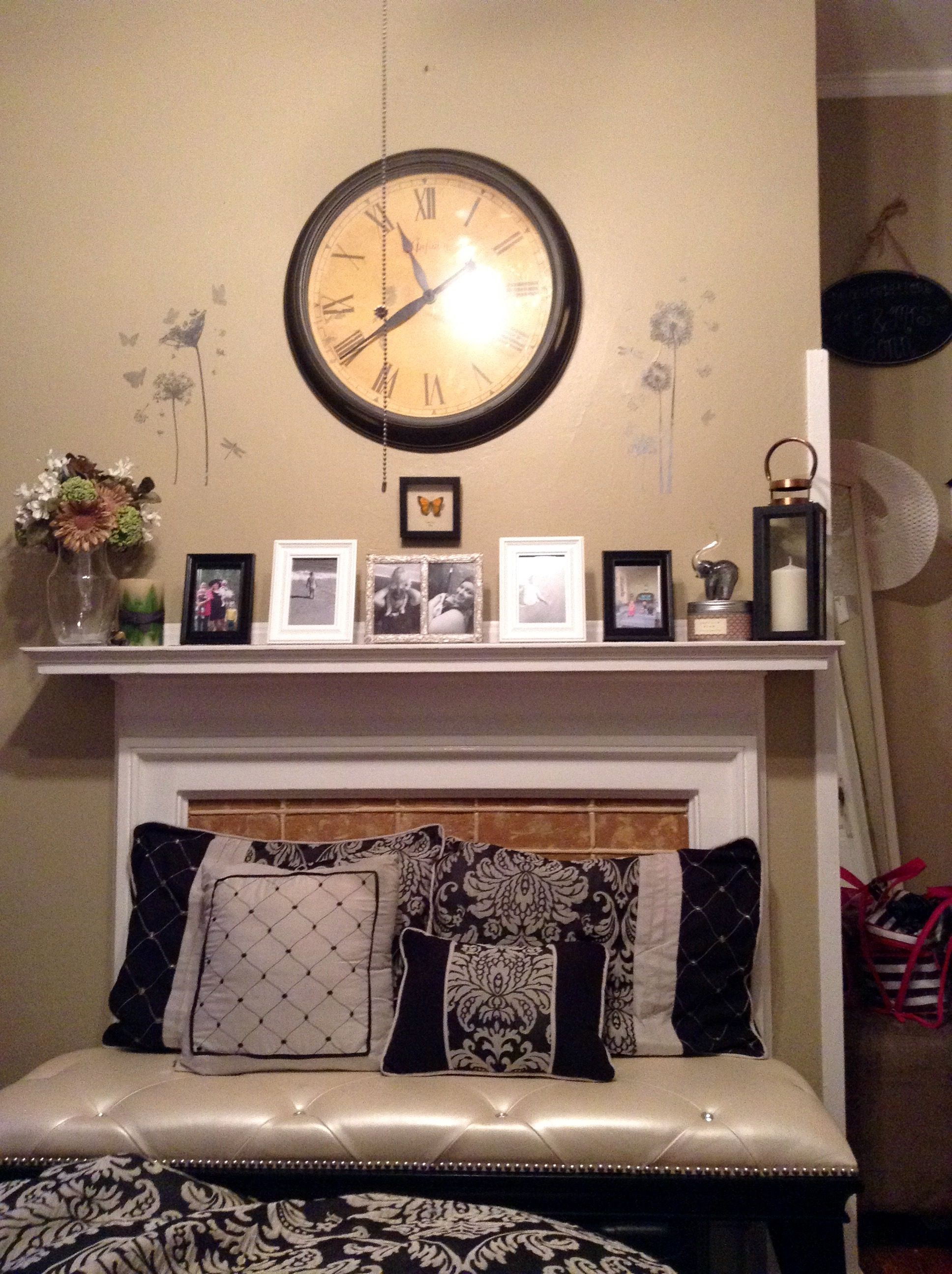 master bedroom fireplace mantle with marilyn bench in front my