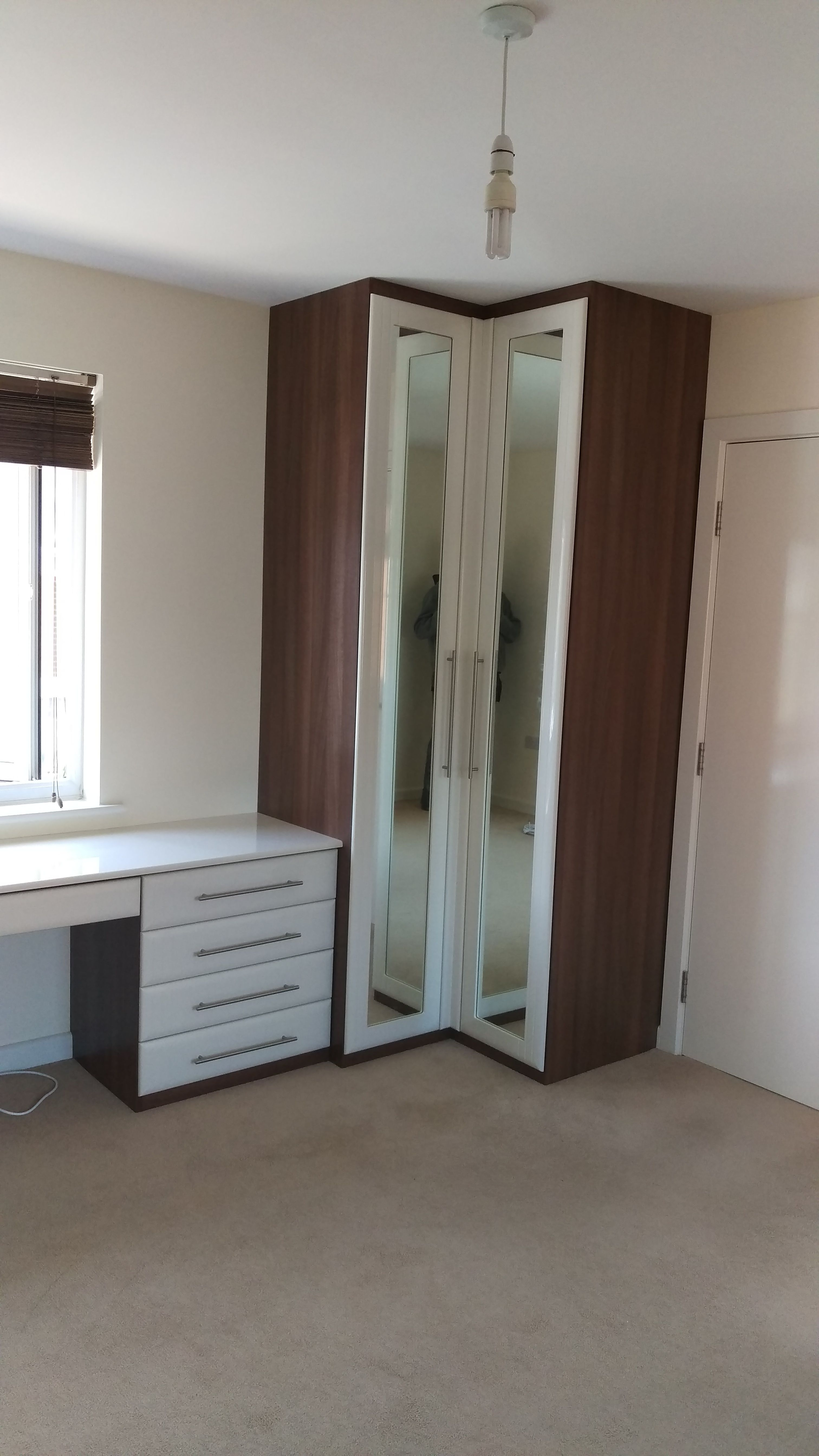 Corner Wardrobe Unit With Dark Walnut Carcass And High Gloss Ivory Fronts And Recessed Mirror