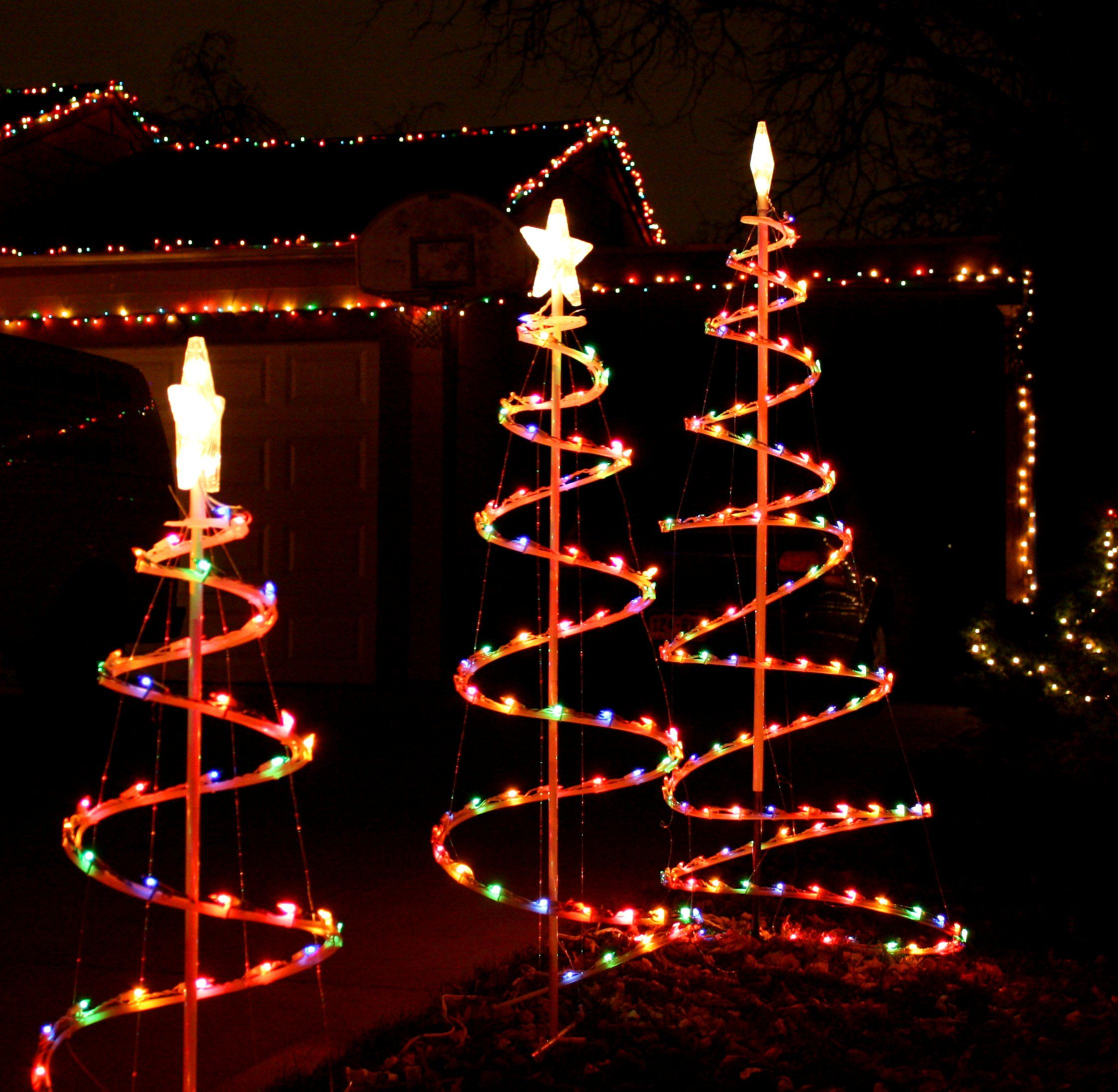 christmas trees pictures this free high resolution photo features three spiral christmas tree