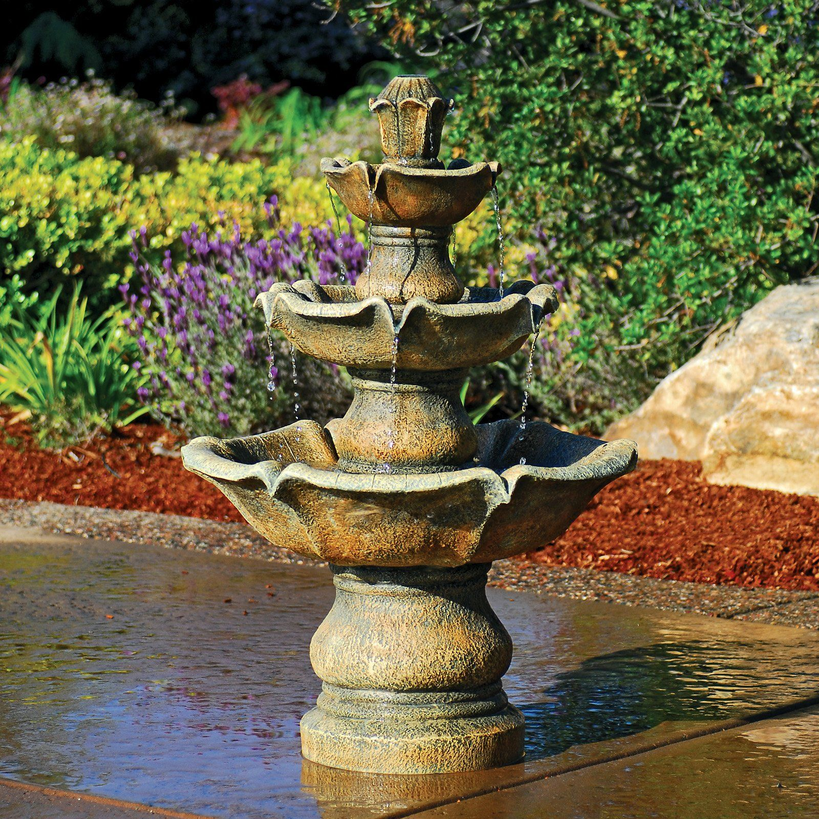 Creative water features your garden with the creative for Backyard water fountain ideas