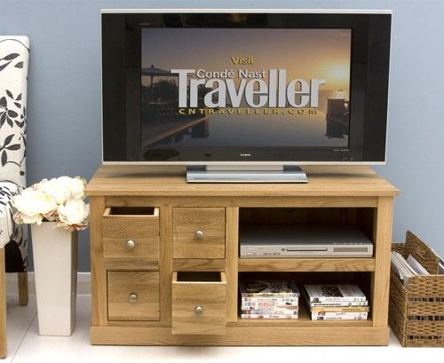 this clean classic mobel oak four drawer television cabinet would suit any living room