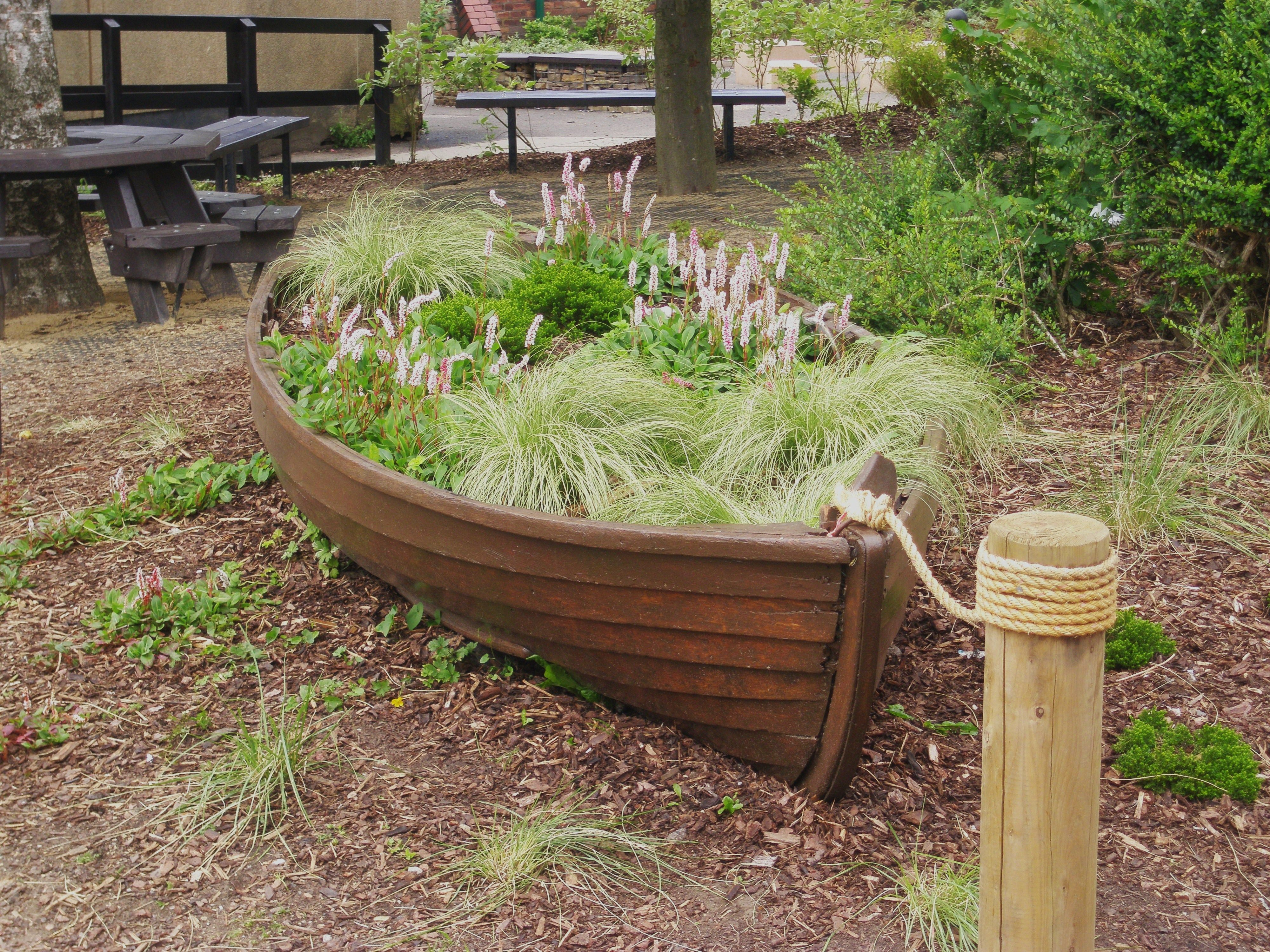 Recycled boat play feature in local primary school grounds Design