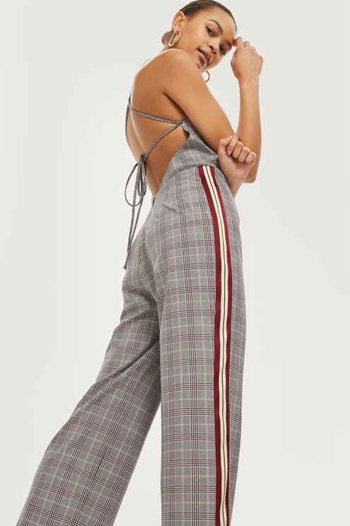 Channel a retro-inspired look with our checked jumpsuit with on-trend side stripe detail. We're styling it with hoop earrings and retro-inspired trainers for a cool, casual look.