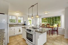 large kitchen islands with stove top | Bright white modern kitchen interior with island and dining area ...