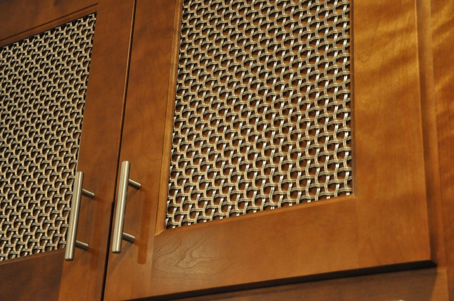Nice Woven Wire Mesh Over Wood Inserts Conceals The Items Within The Cabinets  For A Neat Appearance