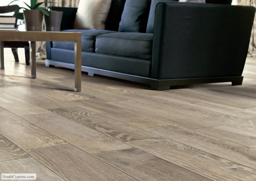 This living room floor is porcelain tile that looks like hardwood. The wood look tile is from the Rustic series and known as French Oak.