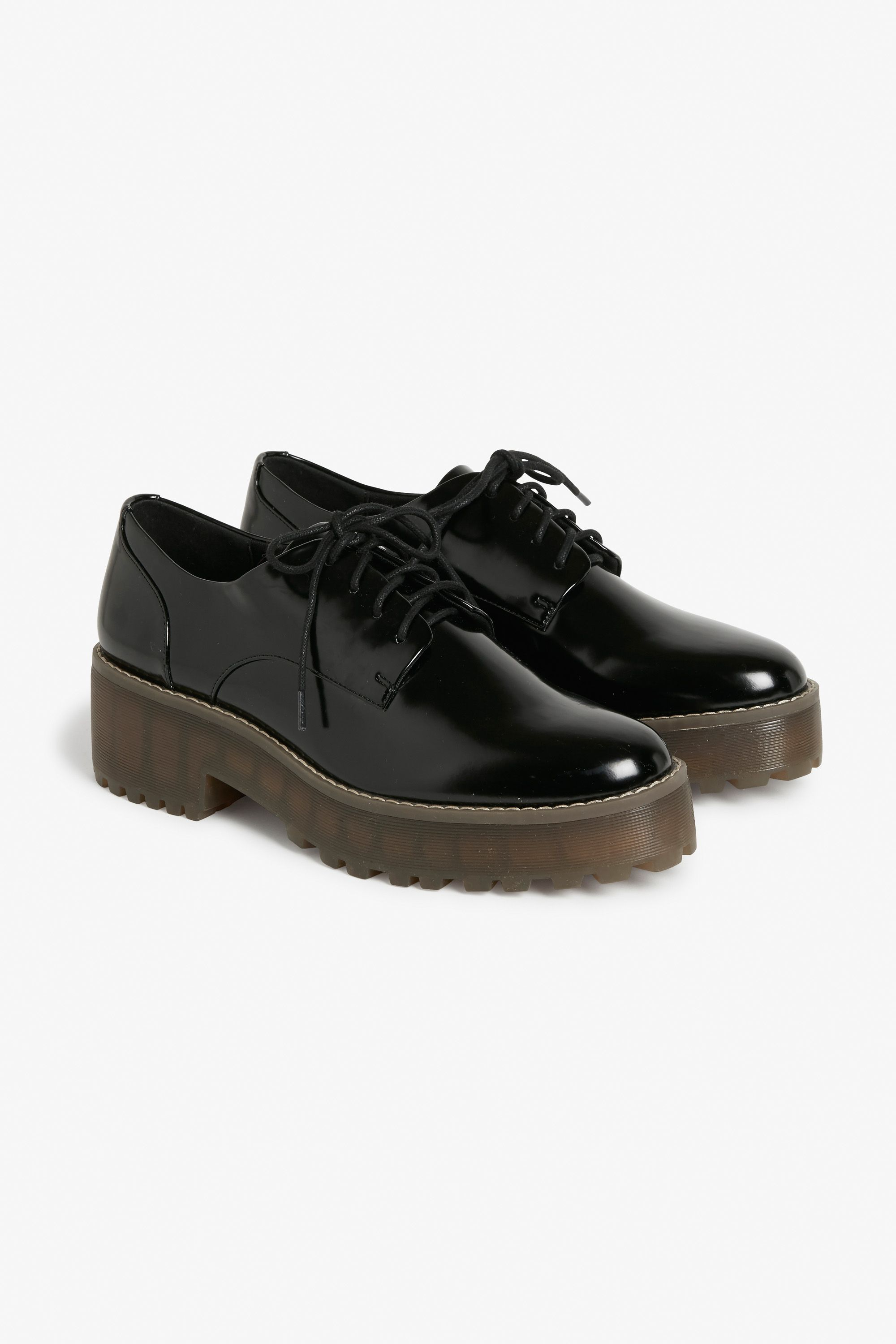 3f99e089447 These shiny wingtip oxfords with their chunky platform soles will elevate  any look you ve put together. Dress  Slammin . Wide leg trousers  Oh yes.