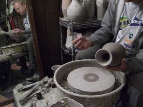 Pottery Spanking Demo with Brass Stamp.   This is a demonstration of adding texture to the sides of a vase to be used for a lamp.