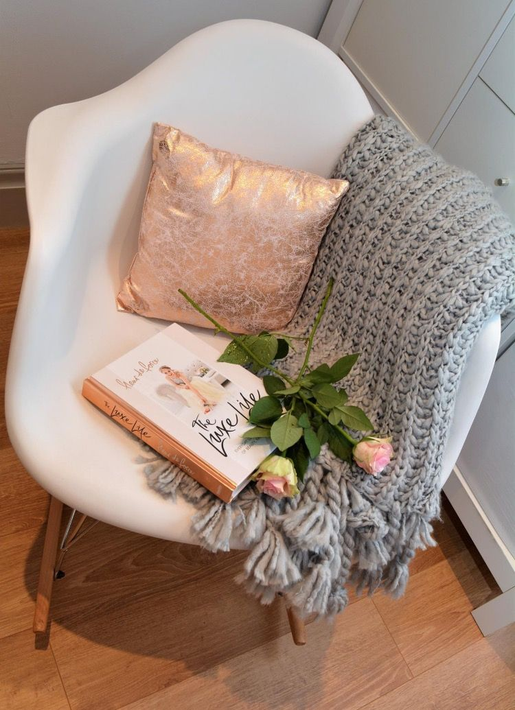 Eames style rocker chair grey chunky knit throw rose
