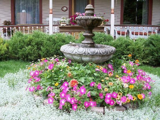 flowers around fountain