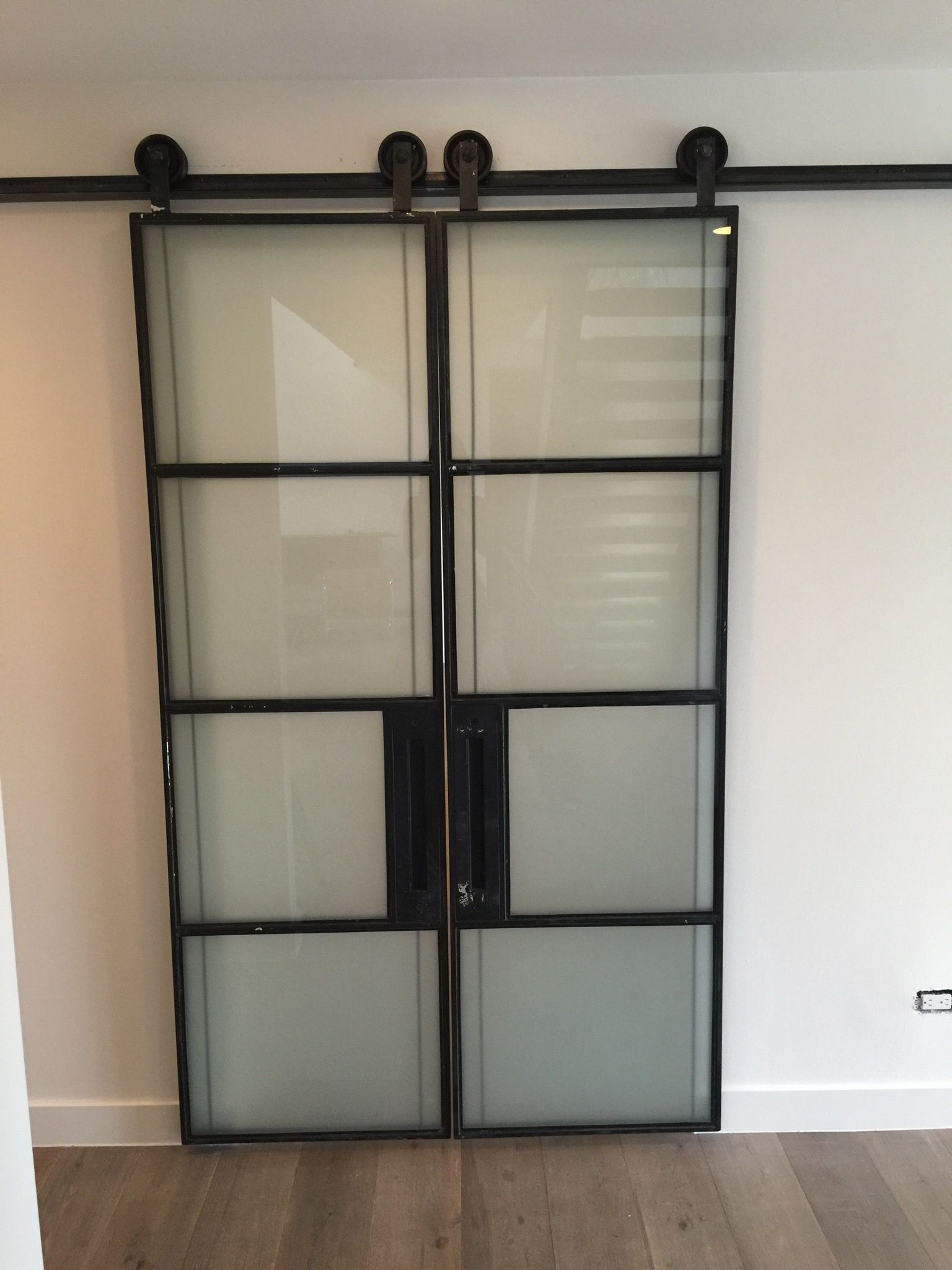 Custom steel and glass warehouse doors with custom track and handle