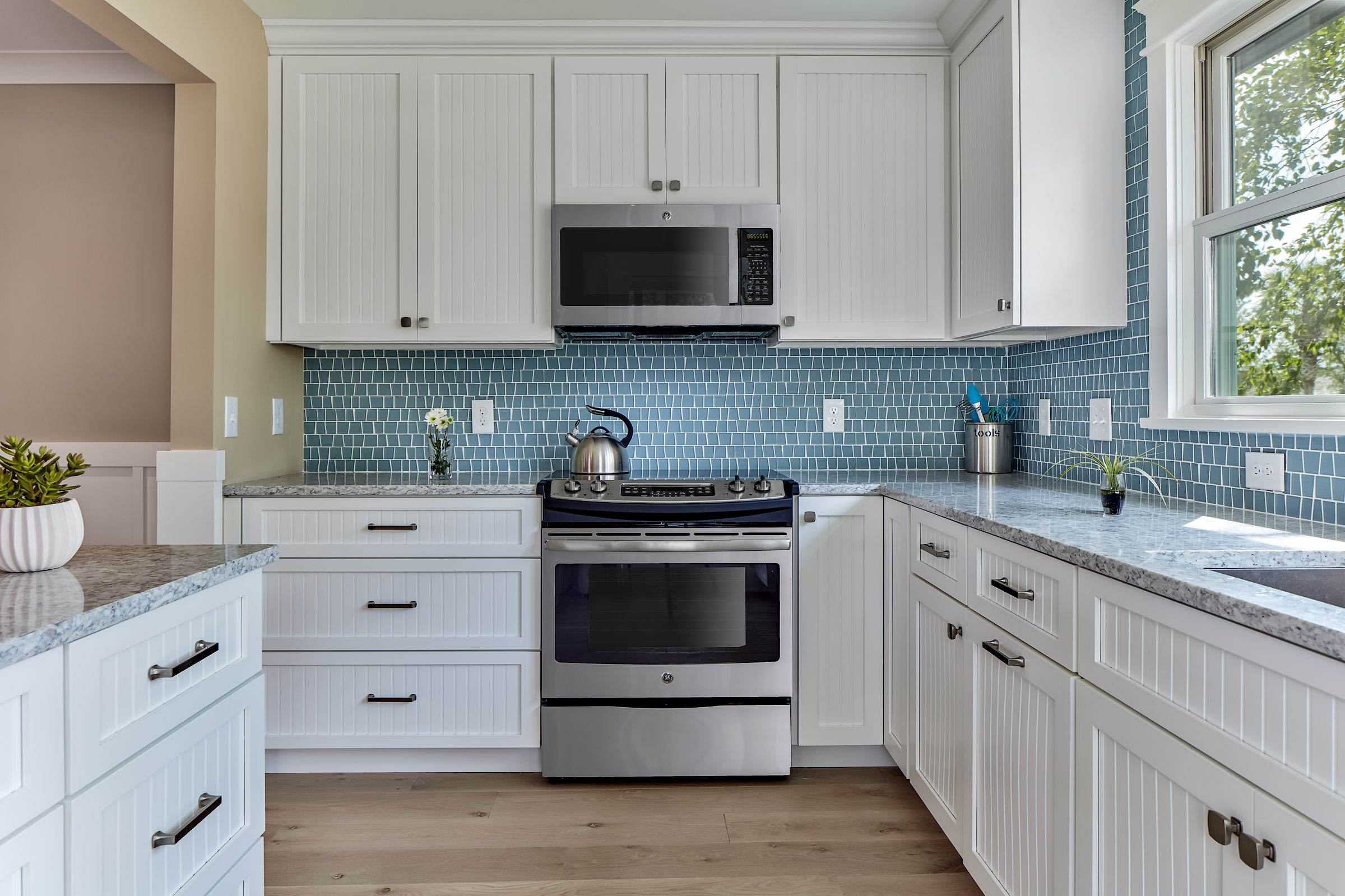 Newly Renovated Kitchen Has All New Stainless Steel Appliances And A Fresh Look With White Cabinets Beauti Kitchen Cabinets Grey Kitchen Grey Kitchen Cabinets