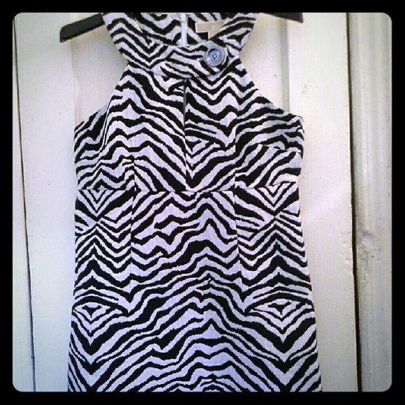 Michael Kors Zebra Stripes Sheath Dress Iconic Michael Michael Kors Black and White Zebra Print with cut-out round neckline with a silver monogrammed brand button. Concealed back zipper, empire waist, fully lined in white taffeta. Dress is cotton and polyester. Great animal print that will take you through multiple seasons. MICHAEL Michael Kors Dresses