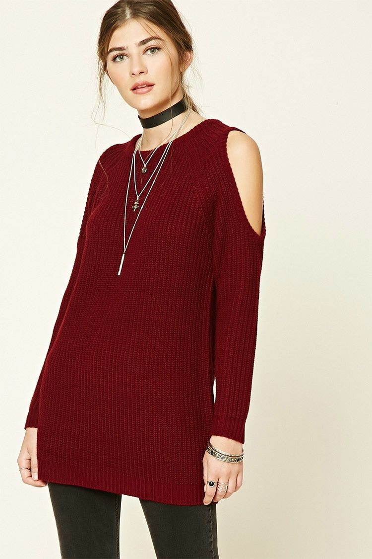27c2f169590573 A midweight knit sweater featuring a longline silhouette